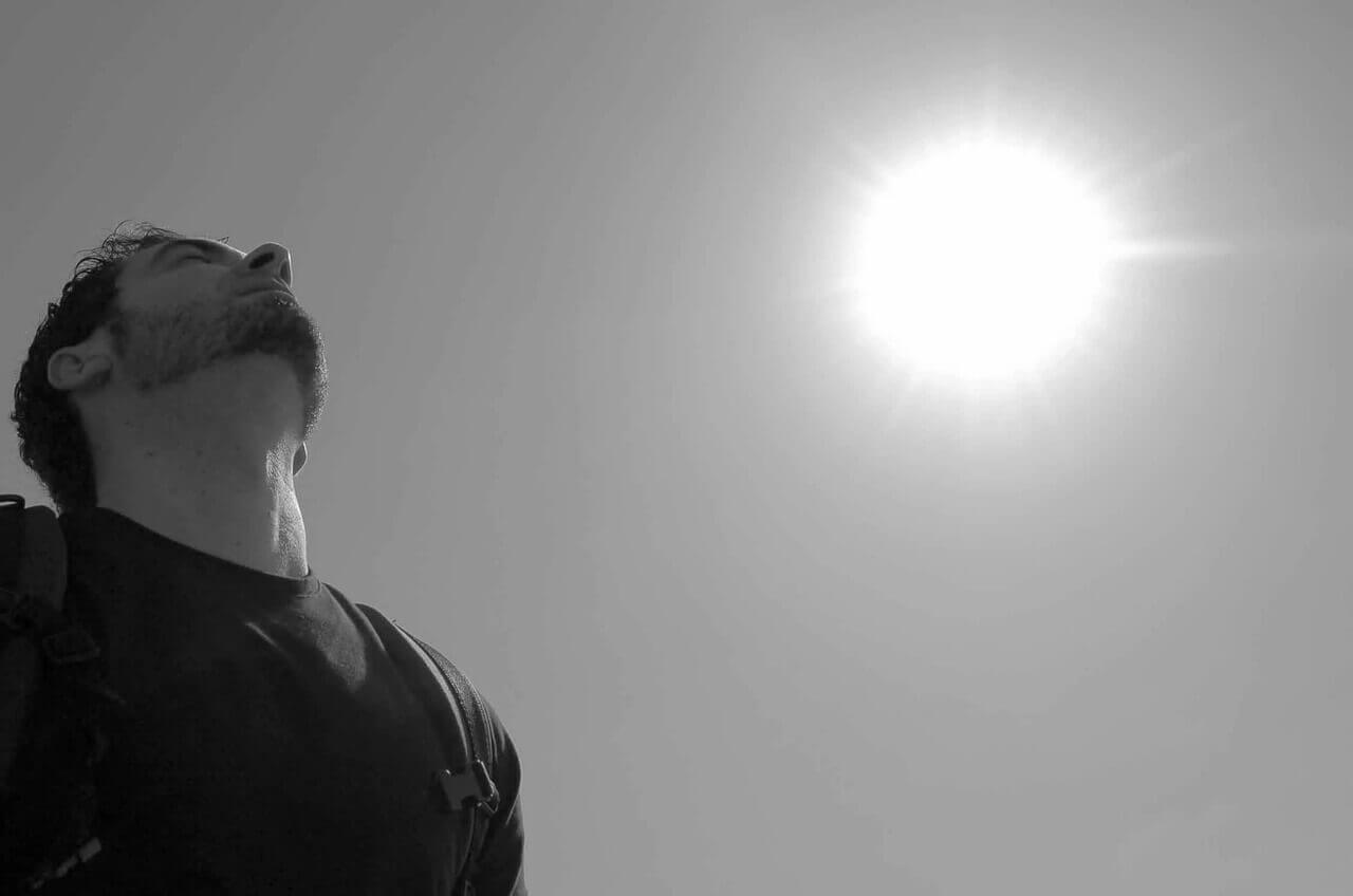 man-looking-at-sky-desert